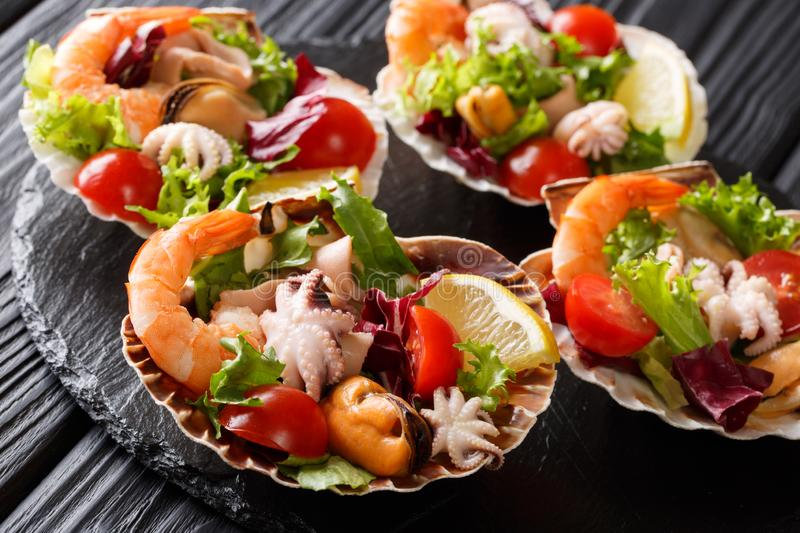 Dietary healthy seafood salad of shrimp, baby octopus, mussels, stock image