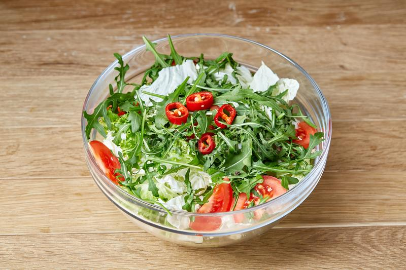 Dietary mixed salad in glass sultana on rustic wooden background, selective focus royalty free stock photography