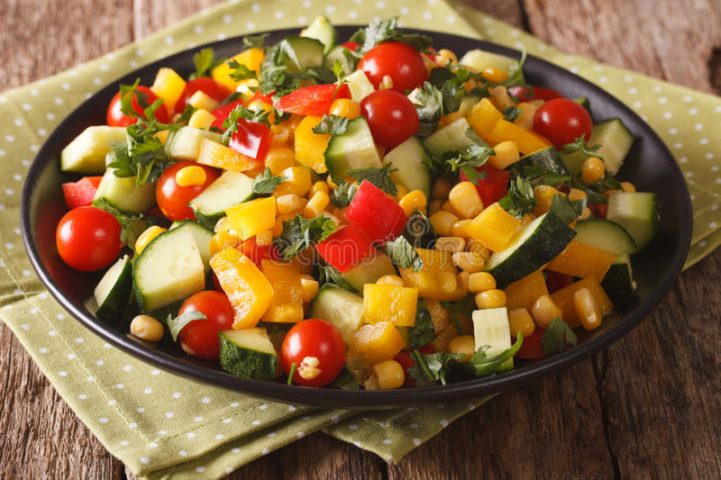 Dietary salad of corn, greens, tomatoes, cucumbers and pepper cl stock photo