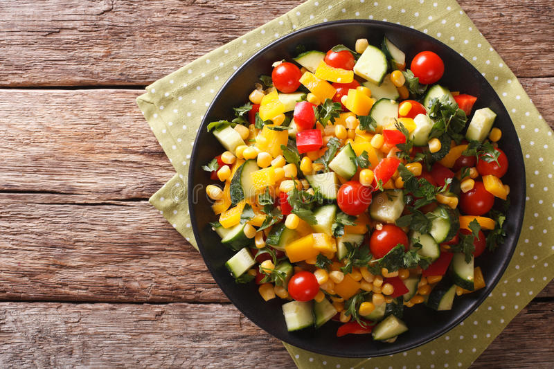 Dietary salad of corn, tomatoes, cucumbers and pepper. horizontal top view stock images