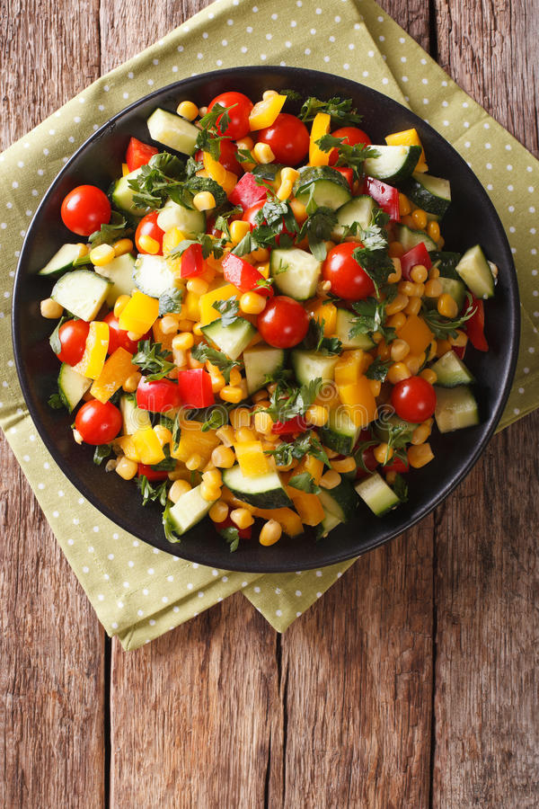 Dietary salad of corn, tomatoes, cucumbers and pepper. vertical stock images