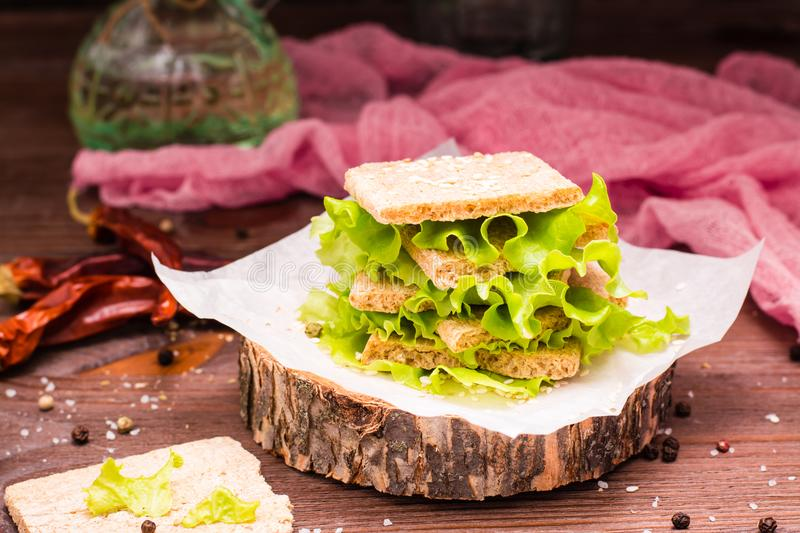 Dietary sandwiches from cereal bread and salad leaves stock images