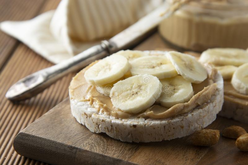 Dietary snack - Peanut butter and banana on rice cakes, healthy, dietary food royalty free stock photo