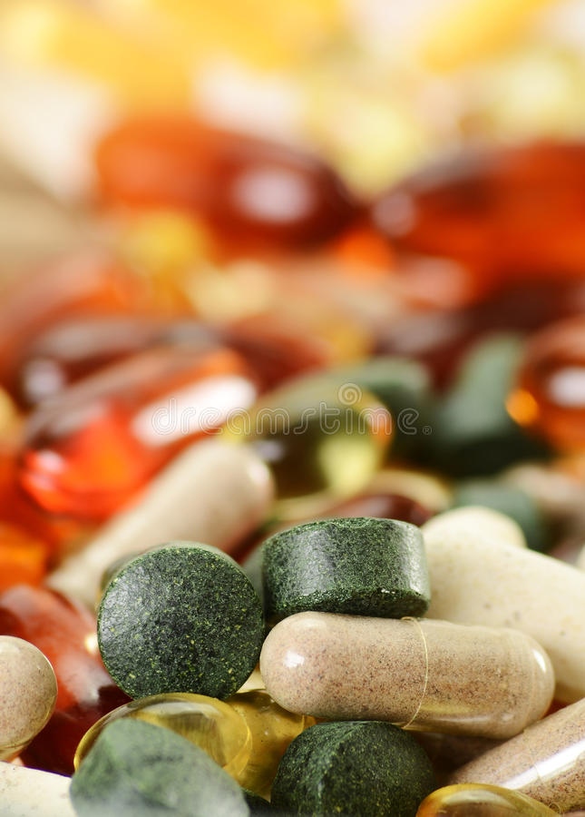 Dietary supplement capsules and tablets. Composition with dietary supplement capsules and tablets stock image