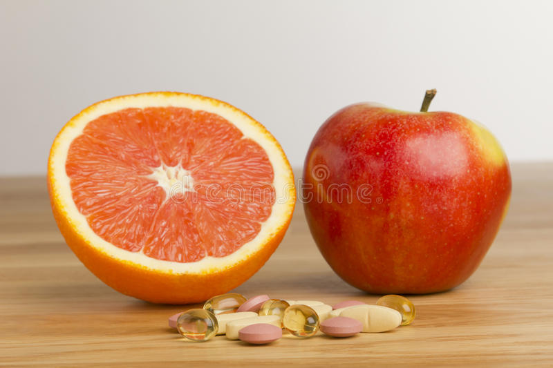 Download Dietary Supplement Vs Fruits Stock Images - Image: 23290354