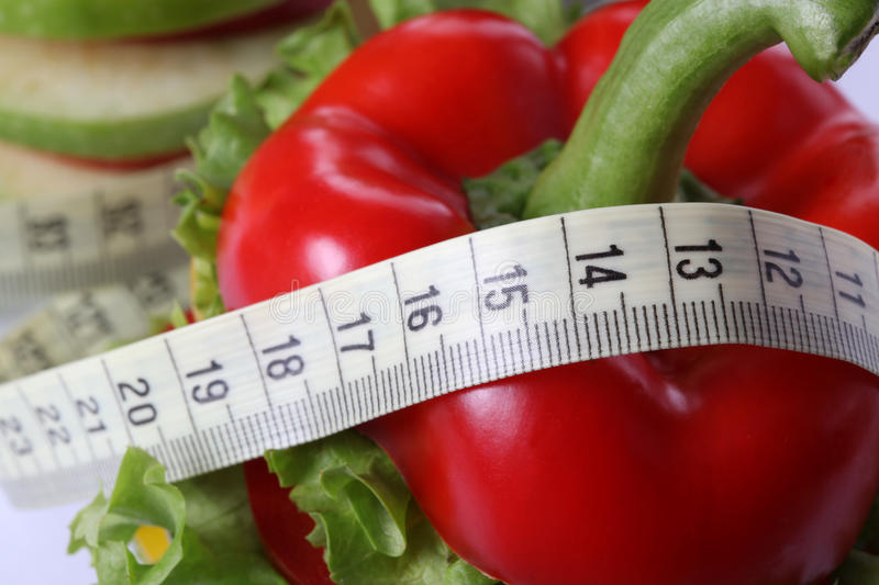 Dieting. Closeup of a bell pepper with measure - concept shot stock photos