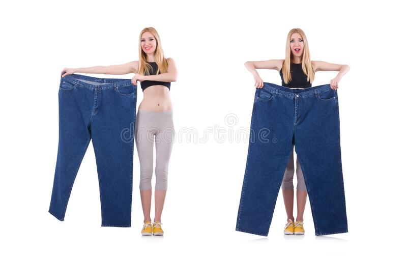 Dieting concept with oversize jeans. The dieting concept with oversize jeans royalty free stock image