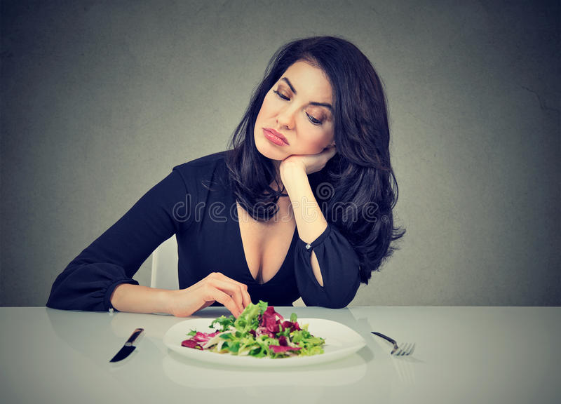 Dieting habits changes. Woman hates vegetarian diet royalty free stock photo