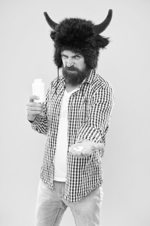 Dieting and health care. Medical treatment. Healthy as bull. Bearded man holding vitamin container. Vitamin supplements stock photography