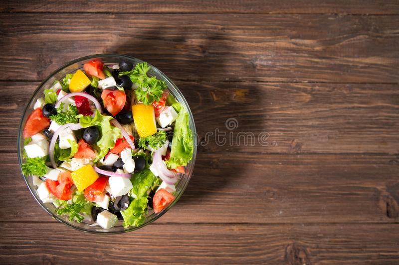 Dieting healthy salad on rustic wooden table top view stock photography