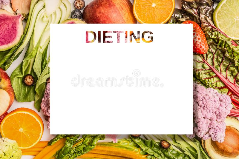 Dieting plan concept. Colorful fruits and vegetables background with blank isolated sheet for your design , top view. stock photos