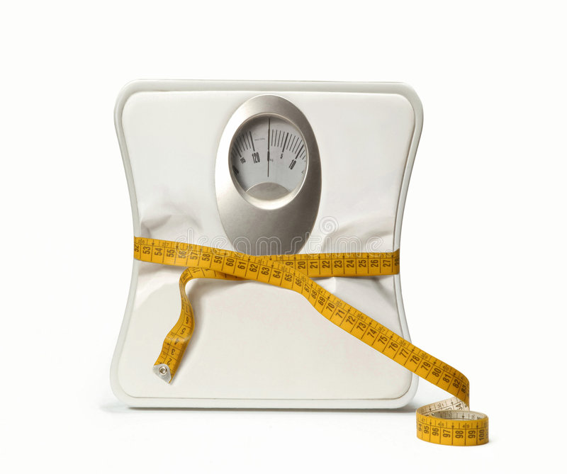 Dieting scale. royalty free stock photo