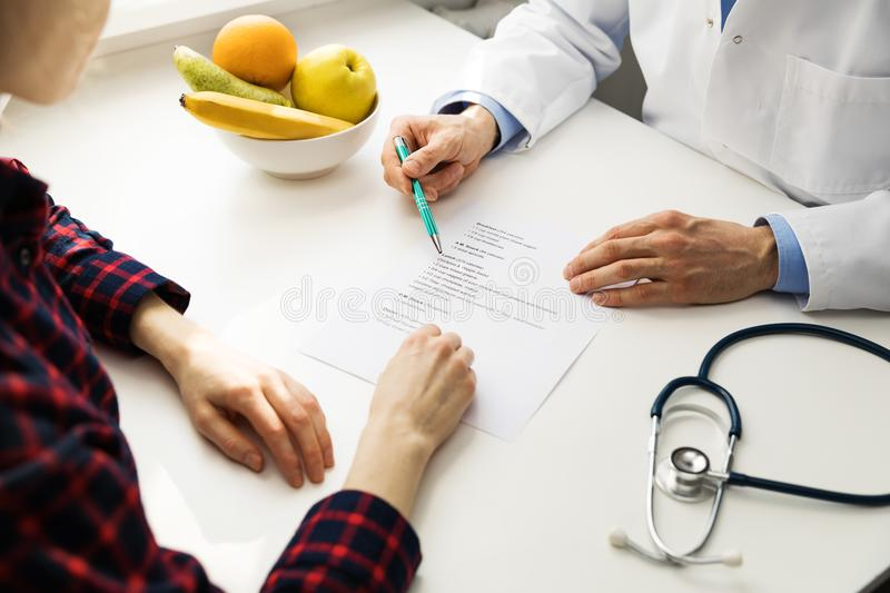 Dietitian consultation. Practitioner and patient discussing diet plan stock images