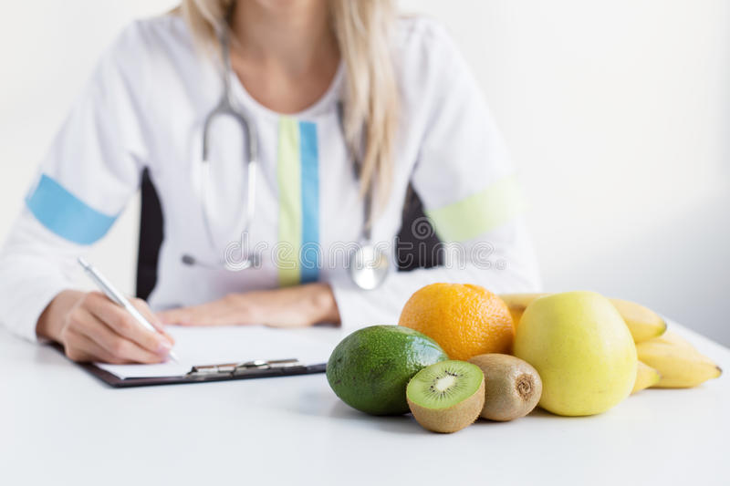 Dietitian doctor. Doctor dietitian recommending healthy food stock images