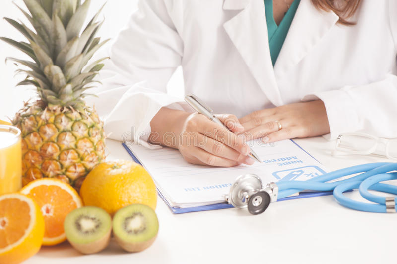 Dietitian doctor. Writing a diet list stock photos