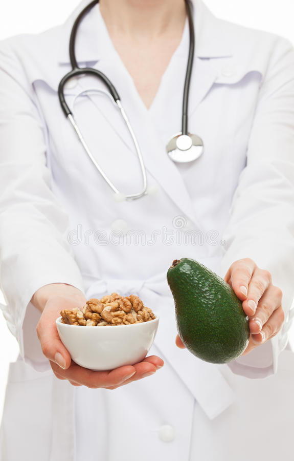 Dietitian proposing avocado and circassian walnut. Closeup shot stock photos