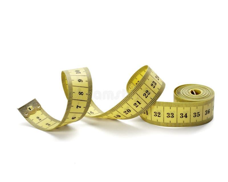 diety sprawności fizycznej długości miara krawczyny taśmy ciężaru fotografia royalty free