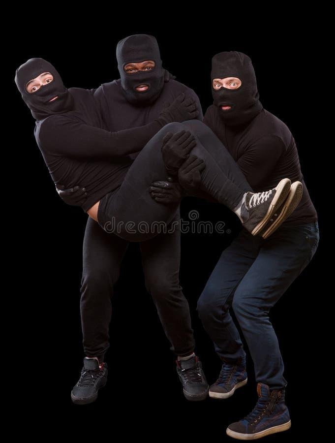 Dieven in maskers stock foto's