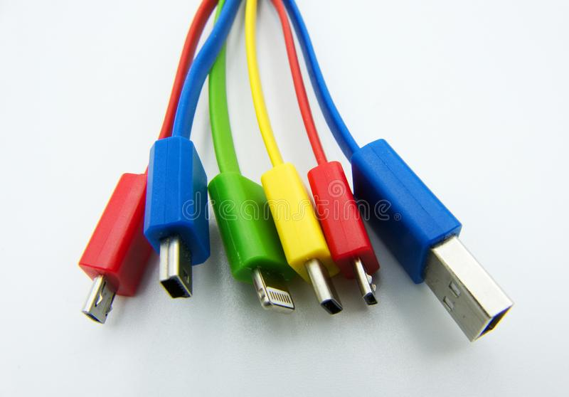 Diferent cables for computer and electronic devices on white background. Diferent cables for computer and electronic devices stock image
