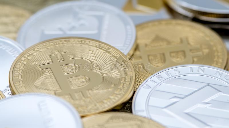 Diferent physical metal currency background. Cryptocurrency coin royalty free stock photography