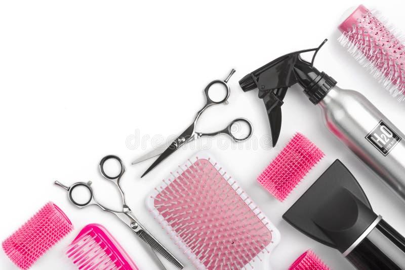 Différents outils de salon de coiffure d'isolement sur le fond blanc avec le copyspace photographie stock