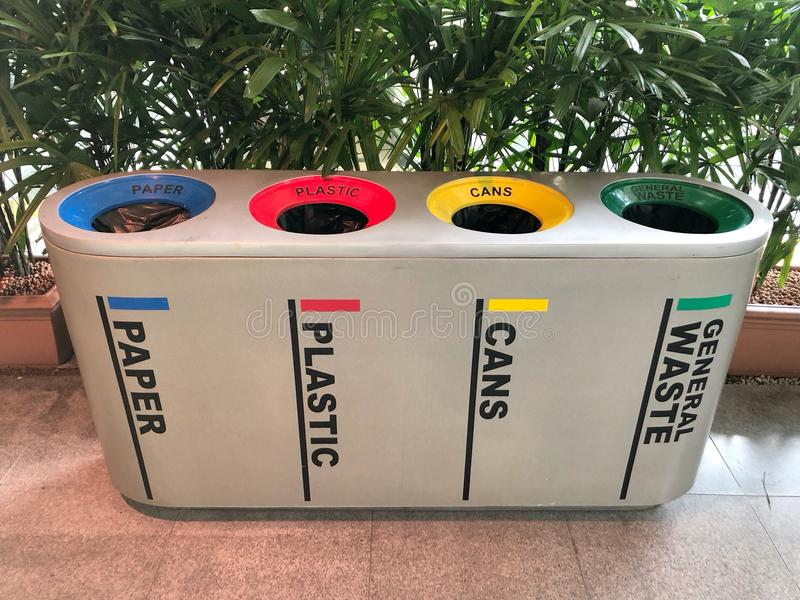 Difference Colored Bins For Collection Of Recycle Materials stock photos