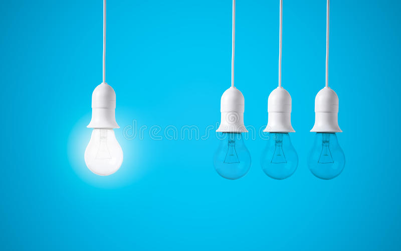 Difference light bulb on blue background. concept of new ideas. With innovation and creativity stock image