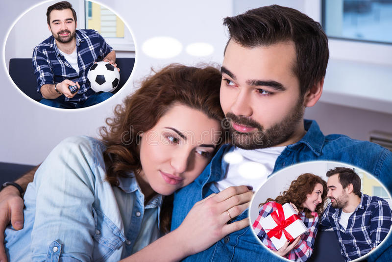Difference between men and women - girl dreaming about presents. And her boyfriend dreaming about football stock photo