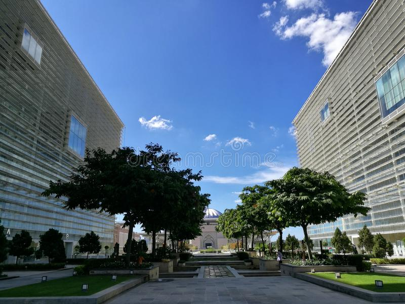 A difference shade between two building and trees. Picture taken at Putrajaya Holding, Putrajaya, Malaysia. A difference shade between two building and trees royalty free stock image