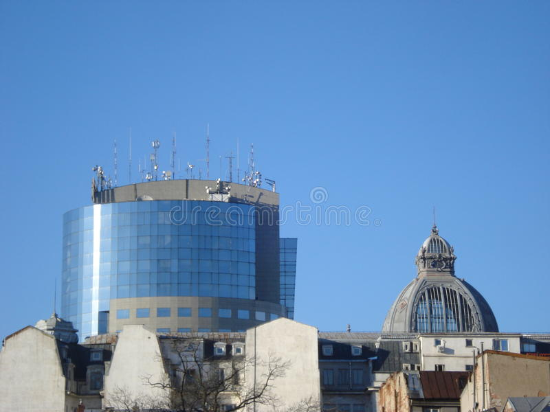 Different ages and styles building roofs in the city. Juxtaposition of architectural styles of different ages building roofs royalty free stock images