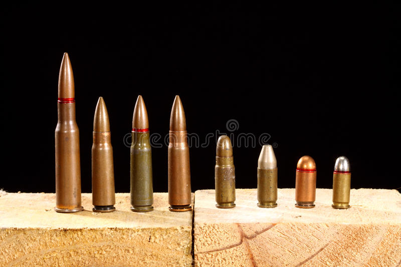Different ammo. Close up over black background royalty free stock photography