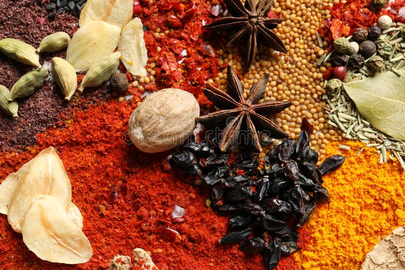 Different aromatic spices as backgroun. D, top view royalty free stock images