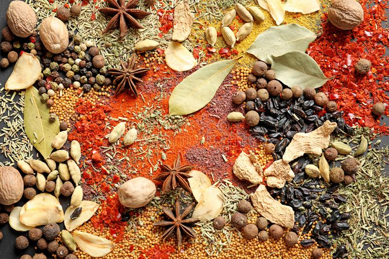 Different aromatic spices as background. Top view royalty free stock photography