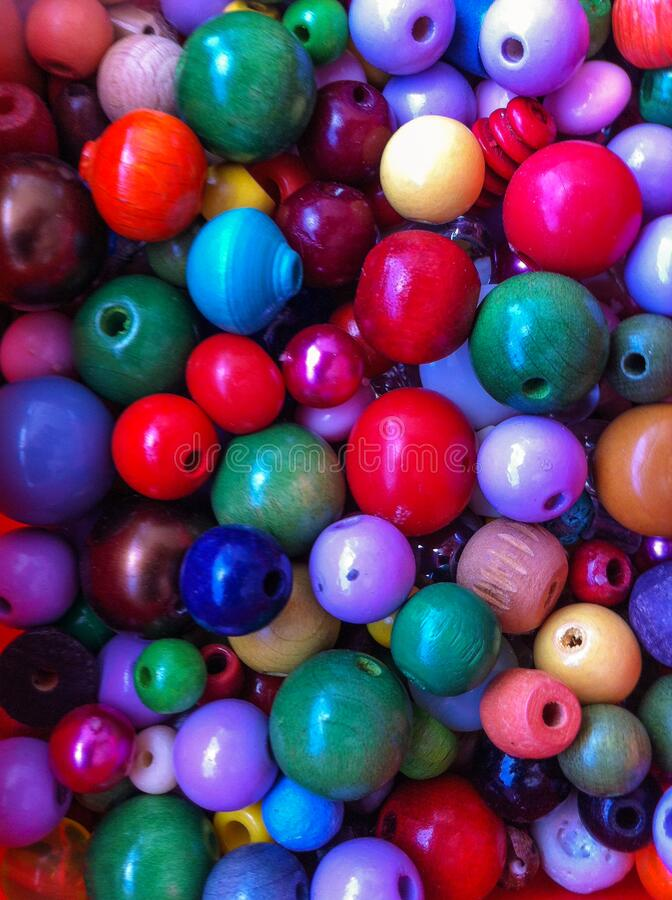 Different beads in various colors for crafts royalty free stock images