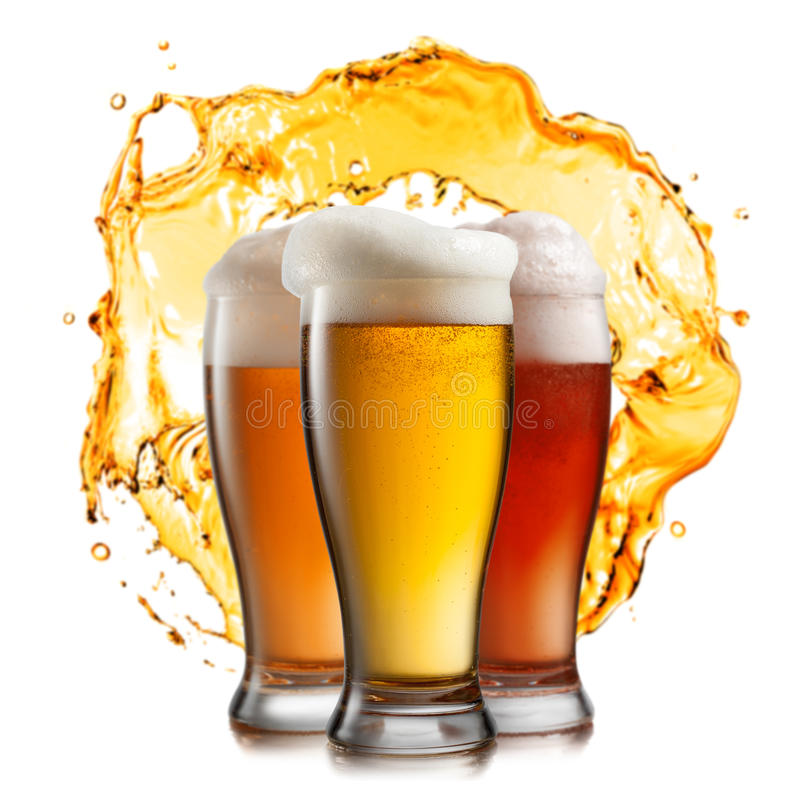 Different beer in glasses with splash royalty free stock photos
