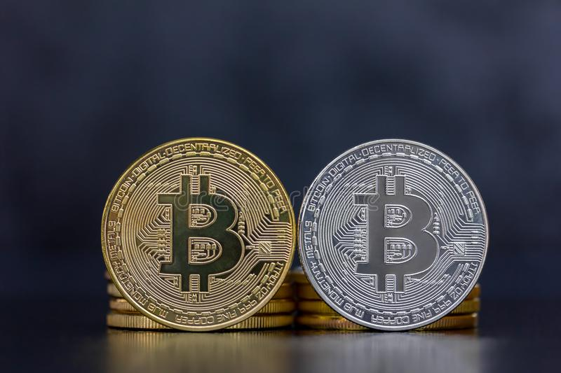 Different Bitcoin coins in gold and silver stock photography