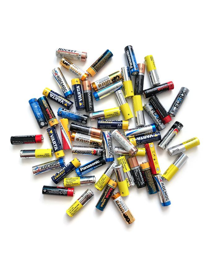 Different brands of colorful batteries on white isolate background, Energy source for portable stock photography