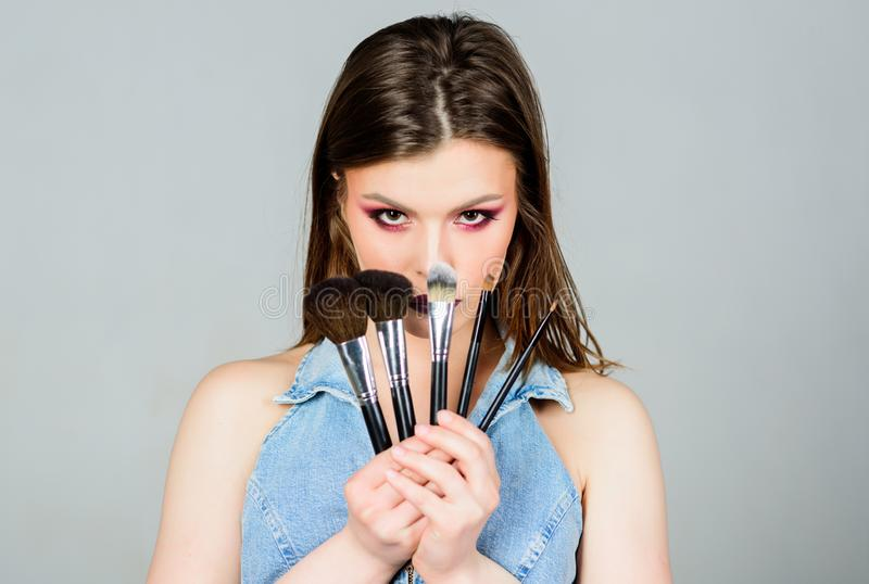 Different brushes. Professional makeup supplies. Skin care. Makeup cosmetics concept. Skin tone concealer. Cosmetics stock image
