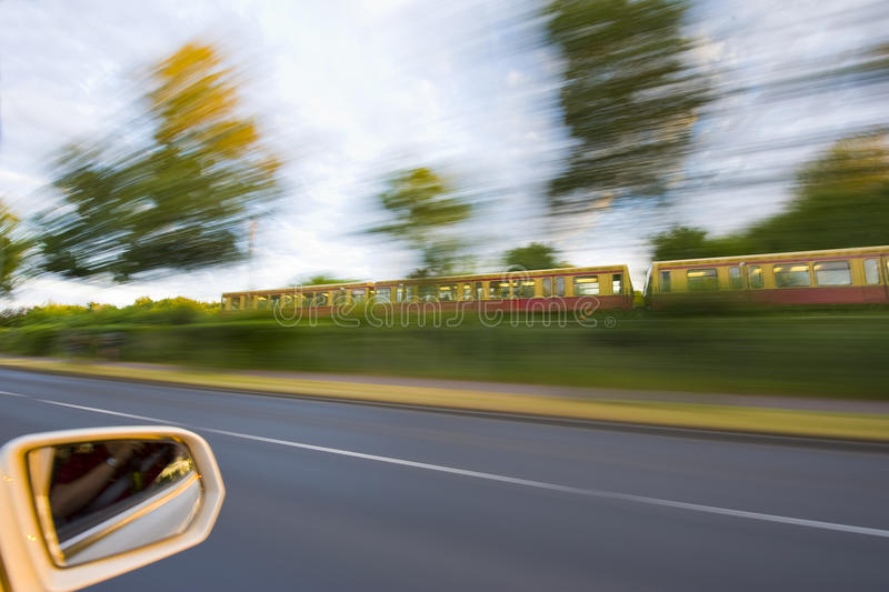 Different daily business travel. Daily business travel speed, image shows different kinds to travel, by car and by train, image taken in full speed from car with stock image