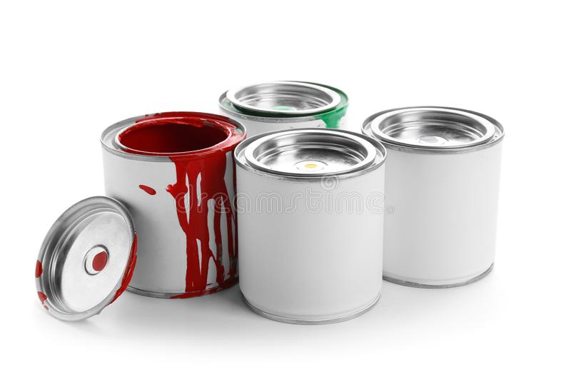 Different cans of paint on white background stock image