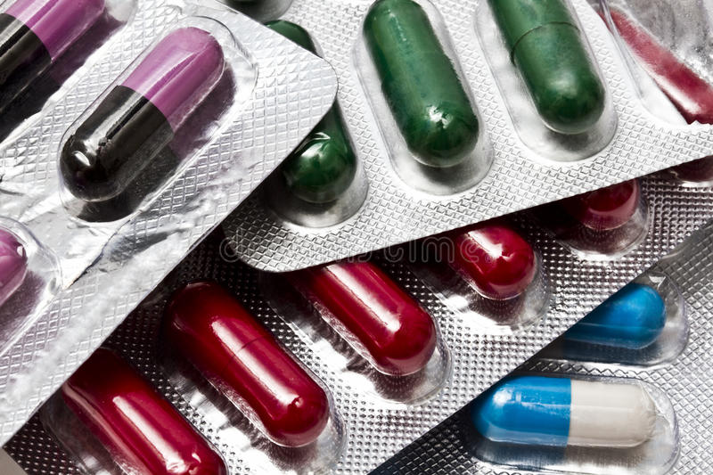 Different capsules and pills royalty free stock images