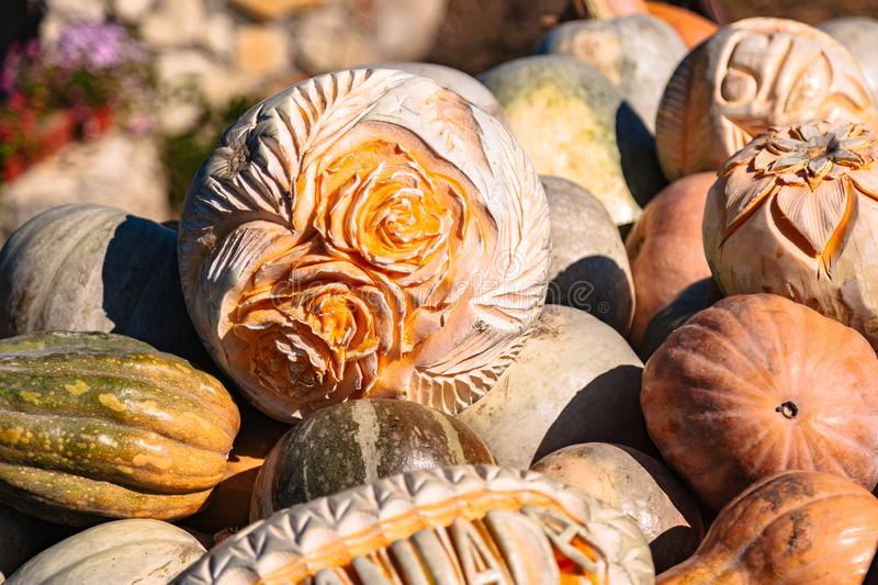 Carving on pumpking in fall farmer market or fair royalty free stock image