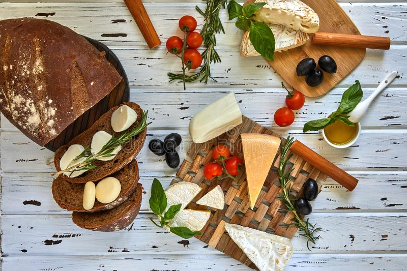 Different cheeses on table. Fresh dairy products stock photos