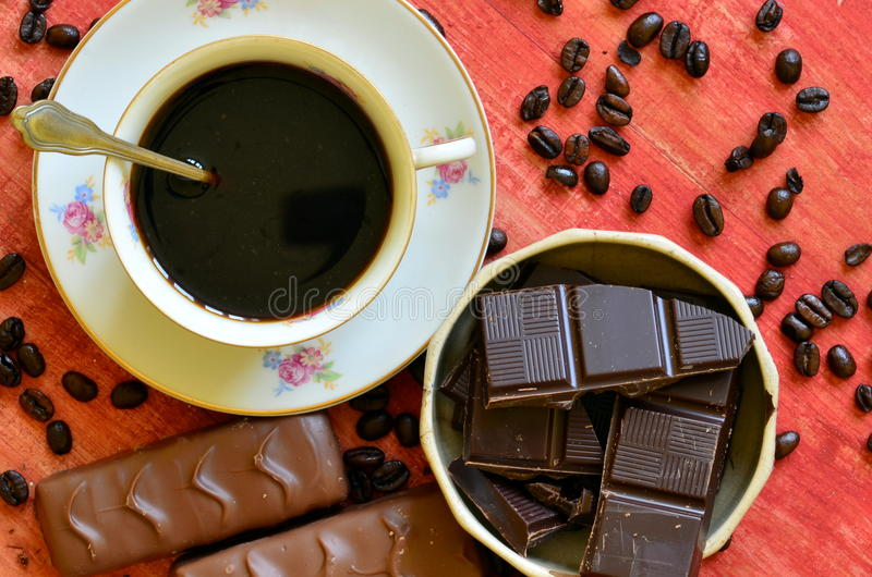 Different chocolate bars and coffee beans and peels of chocolate royalty free stock photography