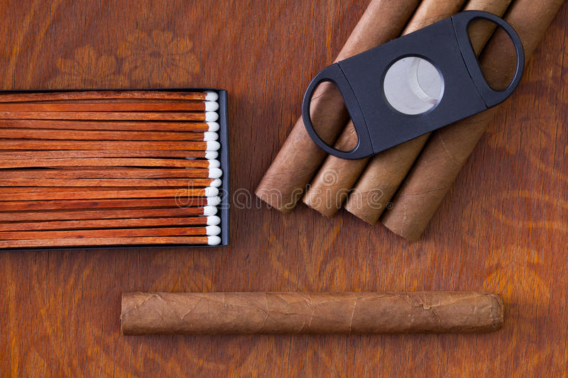 Different cigars on the decorative wooden desk royalty free stock image