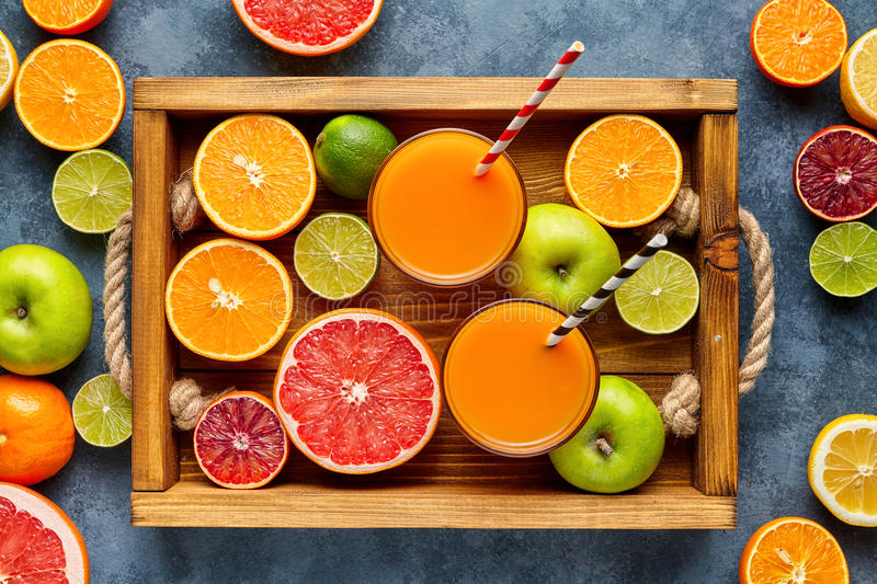 Different citrus fruit on a wooden box and grey concrete table. Fruit food background. Healthy eating. Antioxidant royalty free stock photography