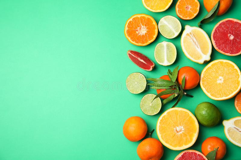 Different citrus fruits on color background, top view. stock photography