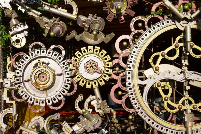 Different cogwheels background. Different cogwheels in some mechanical device background stock photo