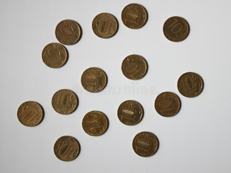 Different coins on the table stock photo