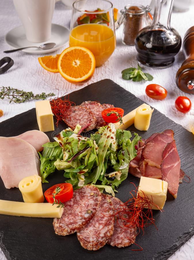 Different cold cuts. For breakfast on restaurant table stock photography